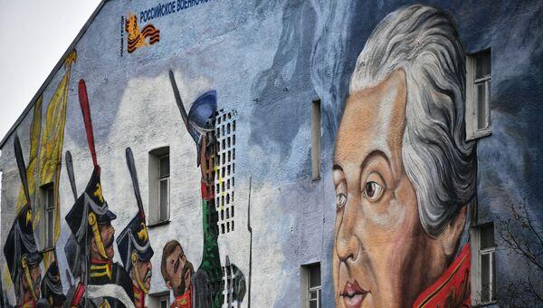 Граффити с Михаилом Кутузовым на фасаде дома в Москве