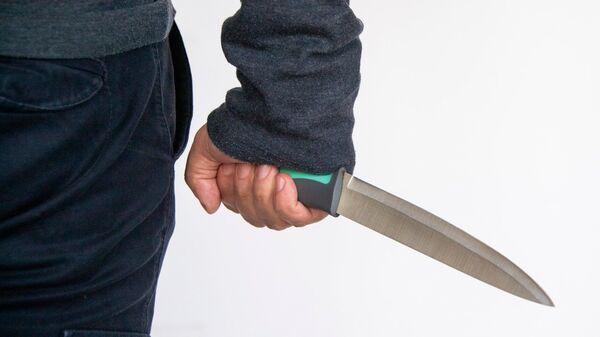 Человек с ножом. Архивное фото
