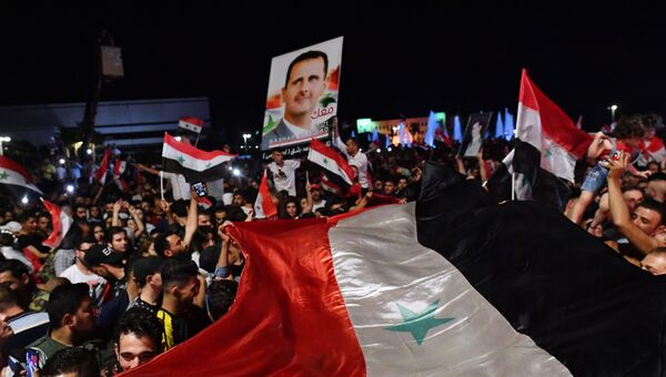 Празднование победы Б. Асада на президентских выборах в Сирии