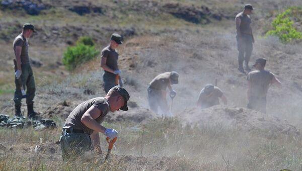 Работа поисковиков в Аджимушкайский каменоломнях