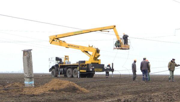 Работы по восстановлению ЛЭП под Херсоном для подачи электричества в Крым