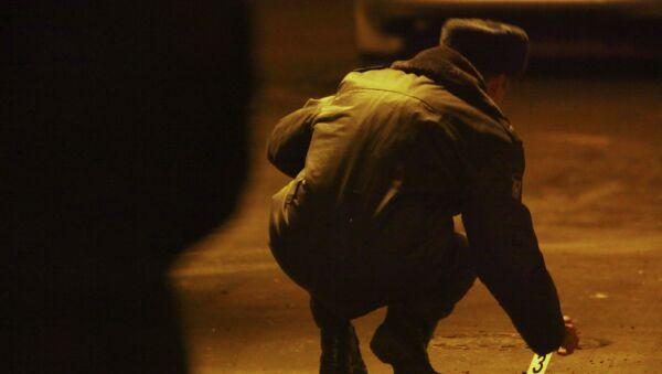 Следственные действия на месте убийства сотрудника правоохранительных органов. Архивное фото