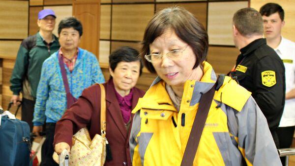 Китайские туристы приехали в Крым. Встреча в симферопольском аэропорту