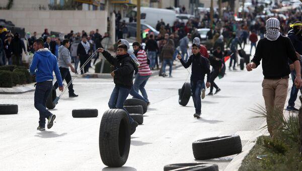 Участники акции протеста в Палестине против решения о признании Иерусалима столицей Израиля