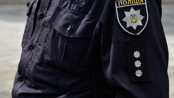Сотрудник Украинской полиции в Киеве. Архивное фото