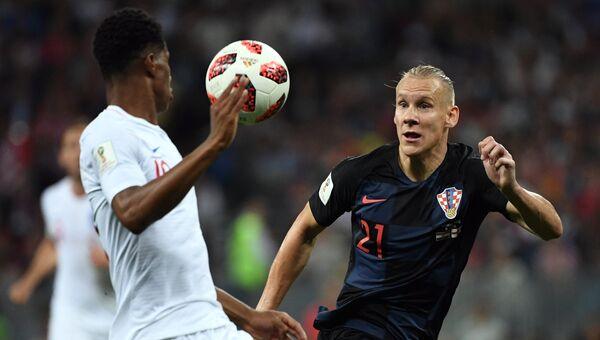 Слева направо: Маркус Рэшфорд (Англия) и Домагой Вида (Хорватия) в полуфинальном матче чемпионата мира по футболу между сборными Хорватии и Англии. 11 июля 2018