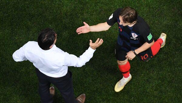 Слева направо: главный тренер Златко Далич (Хорватия) и Лука Модрич (Хорватия) в полуфинальном матче чемпионата мира по футболу между сборными Хорватии и Англии. 11 июля 2018