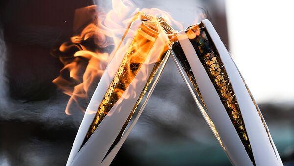 Факелы во время эстафеты. Архивное фото