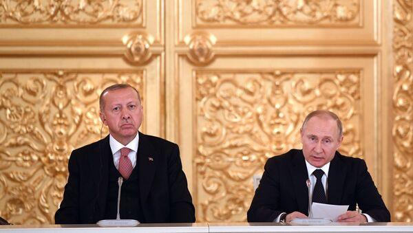 Президент РФ Владимир Путин и президент Турции Реджеп Тайип Эрдоган во время встречи с ведущими представителями деловых кругов двух стран. 8 апреля 2019