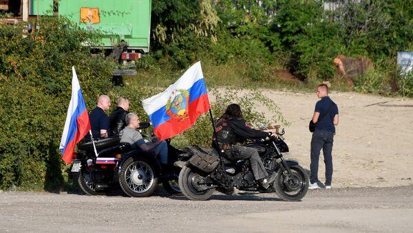 Владимир Путин, Сергей Аксенов и Михаил Развожаев на байк-шоу в Севастополе