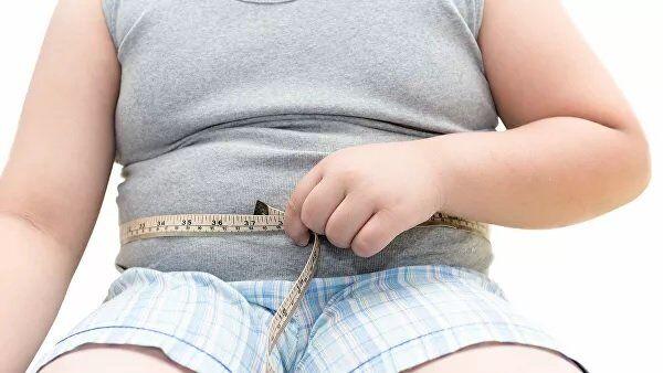 Человек с лишним весом. Архивное фото