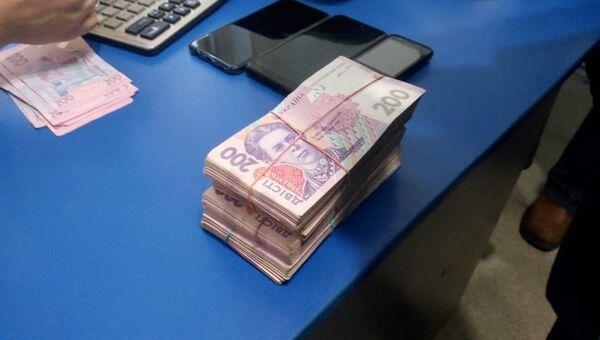 Херсонский депутат вымогал деньги, угрожая крымчанину